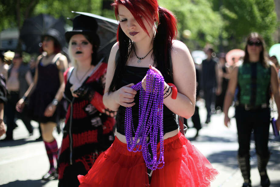 A participant holds onto beads during the annual Pride Parade. Photo: JOSHUA TRUJILLO, SEATTLEPI.COM