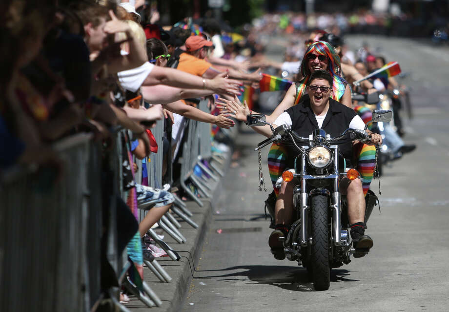 Members of Dykes on Bikes are greeted by spectators  during the annual Pride Parade. Photo: JOSHUA TRUJILLO, SEATTLEPI.COM