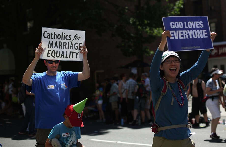 People hoist signs during the annual Pride Parade. Photo: JOSHUA TRUJILLO, SEATTLEPI.COM