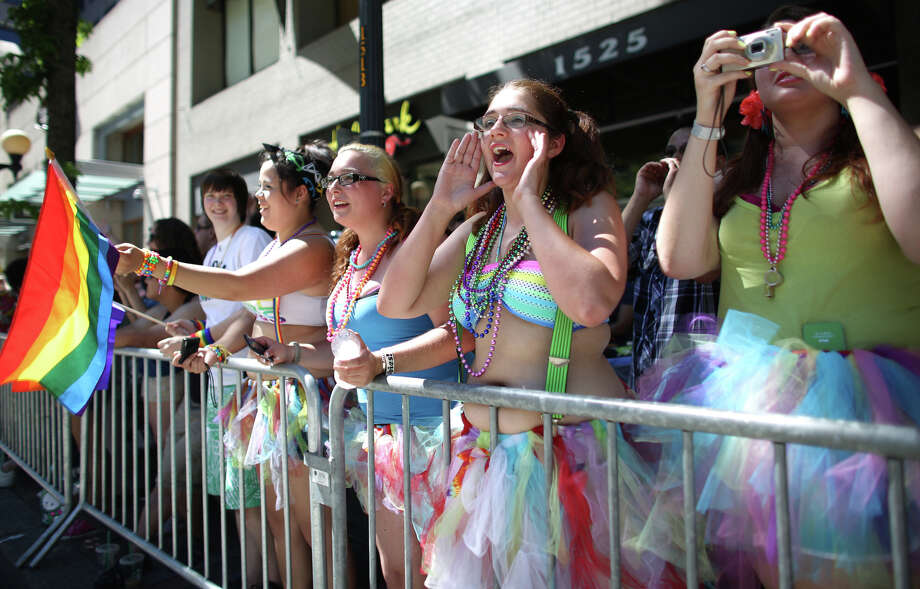 Spectators cheer during the annual Pride Parade. Photo: JOSHUA TRUJILLO, SEATTLEPI.COM