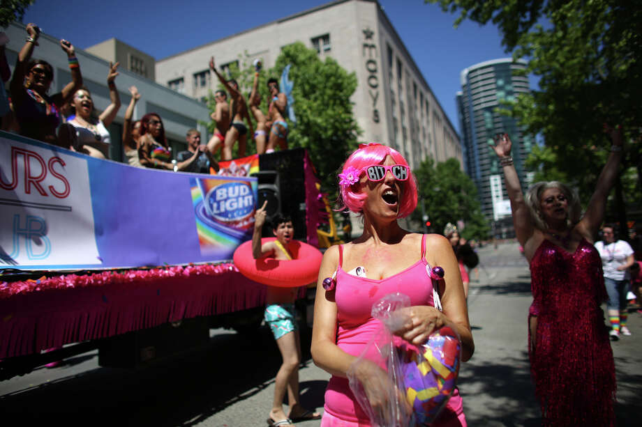 Participants on the Neighbours float throw up their arms during the annual Pride Parade. Photo: JOSHUA TRUJILLO, SEATTLEPI.COM