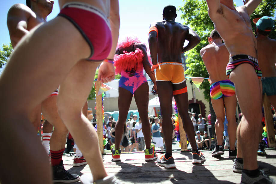 People dance during the annual Pride Parade. Photo: JOSHUA TRUJILLO, SEATTLEPI.COM