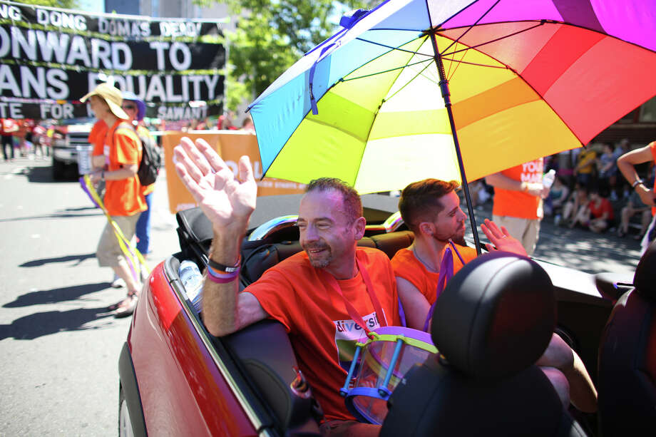 "Timothy Ray Brown, also known as the ""Berlin patient,"" waves from a car during the annual Pride Parade. Brown is the first person cured of HIV. Photo: JOSHUA TRUJILLO, SEATTLEPI.COM"
