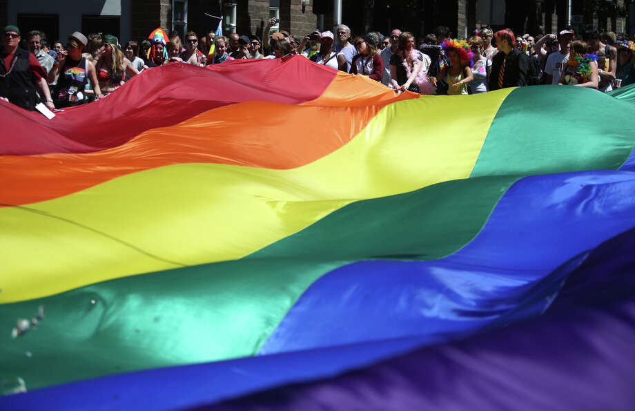 A giant pride flag is carried during the annual Pride Parade. Photo: JOSHUA TRUJILLO, SEATTLEPI.COM