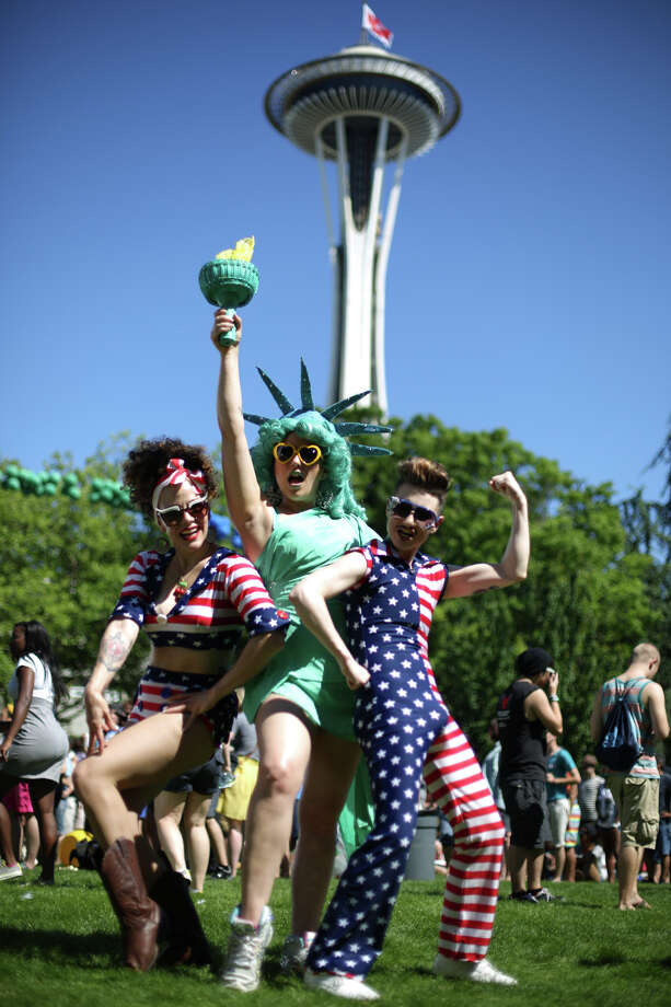 From left, J. Von Stratton, Kitten LaRue and  Lou Henry Hoover strike a pose during the annual Pride Fest. Photo: JOSHUA TRUJILLO, SEATTLEPI.COM