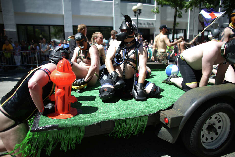 Men ride on a float during the annual Pride Parade. Photo: JOSHUA TRUJILLO, SEATTLEPI.COM