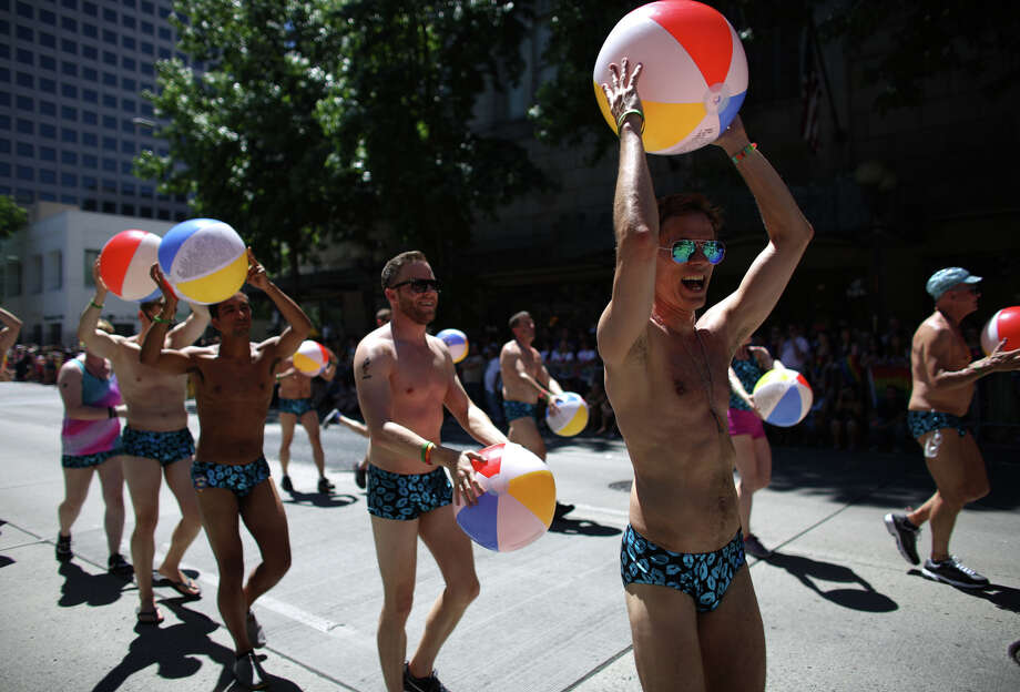 Members of the Orcas Swim Team march during the annual Pride Parade. Photo: JOSHUA TRUJILLO, SEATTLEPI.COM