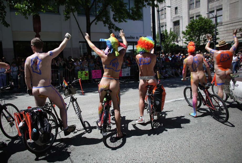 Naked bike riders stop to wave to the crowd during the annual Pride Parade. Photo: JOSHUA TRUJILLO, SEATTLEPI.COM