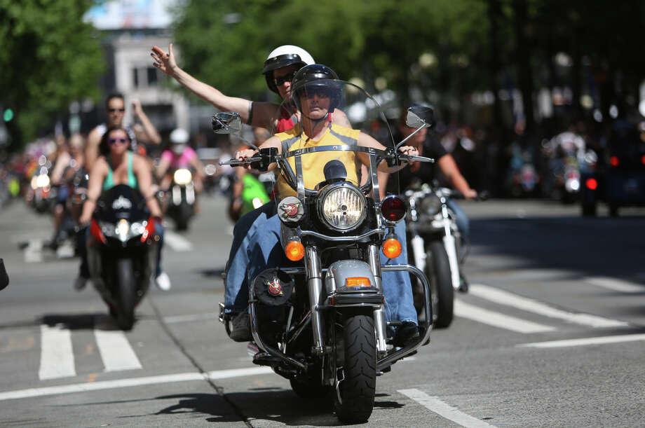 Members of Dykes on Bikes ride on Fourth Avenue during the annual Pride Parade. Photo: JOSHUA TRUJILLO, SEATTLEPI.COM