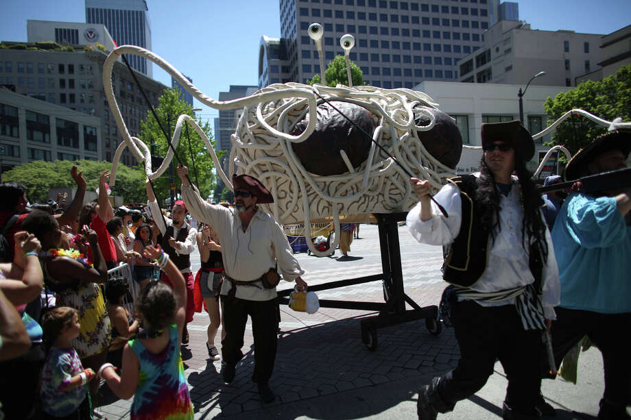 The Spaghetti Monster is paraded along the route during the annual Pride Parade on Sunday, June 30, 2013 in Seattle. Hundreds of thousands of people came to downtown Seattle to celebrate Pride, on the heels of a U.S. Supreme Court decision on DOMA and California's Proposition 8 and last year's legalization of same-sex marriage by voters in Washington State. Photo: JOSHUA TRUJILLO, SEATTLEPI.COM