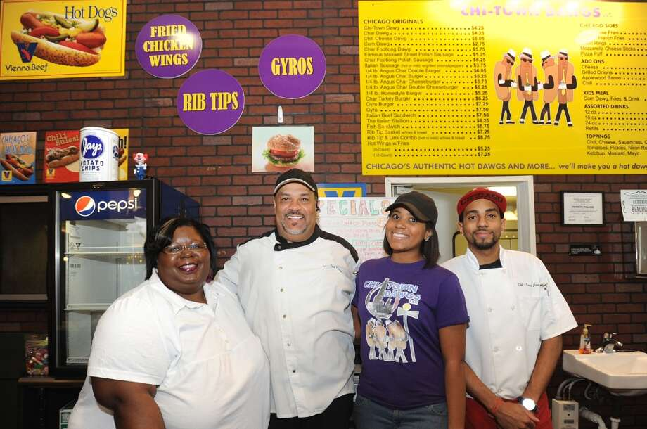 From left, Denice Wallace, Kenneth Wallace, Bianca Wallace, and Wallace Jr. at Chi-Town Dawgs in Parkdale Mall. Photo taken June 20, 2013 Guiseppe Barranco/The Enterprise