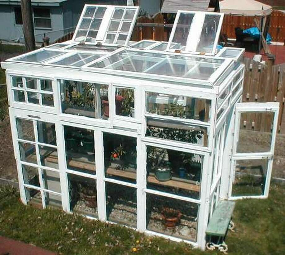 Greenhouses of any size can be constructed from old windows. Photo via Phastastic Phinds blog.