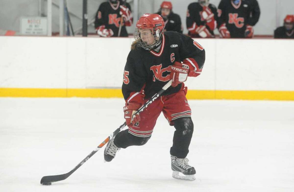 New Canaan's Jana Persky in action as Greenwich High hosts New Canaan in a girls hockey game at Dorothy Hamill Saturday afternoon, January 16, 2010.
