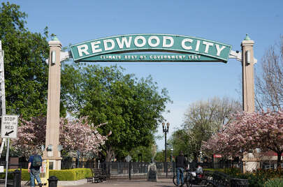 Know which town has the slogan 'Climate best by government test.' (Redwood City)