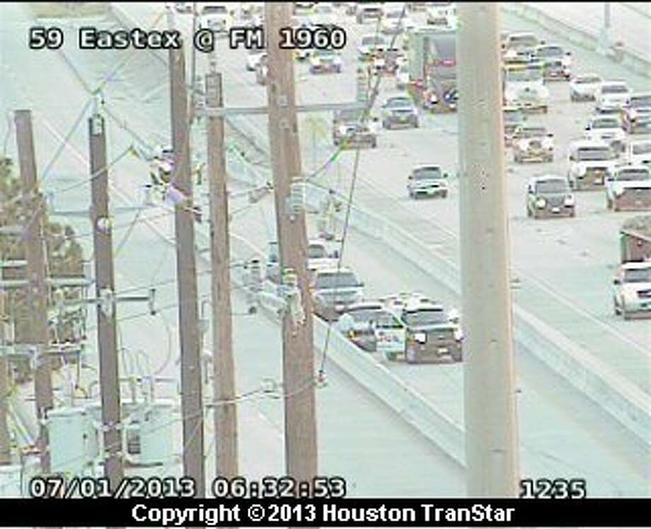 Traffic was slowed on the inbound Eastex Freeway near FM 1960 frontage road as police investigate an officer-involved shooting early Monday morning. Photo: Houston Transtar