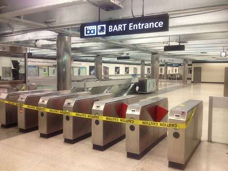 Closed turnstiles at the Powell BART Station in downtown San Francisco early on Monday, July 1, 2013, the first day of the first BART strike since 1997. Roughly 400,000 thousand riders were stranded by the strike. Photo: Will Kane, The Chronicle