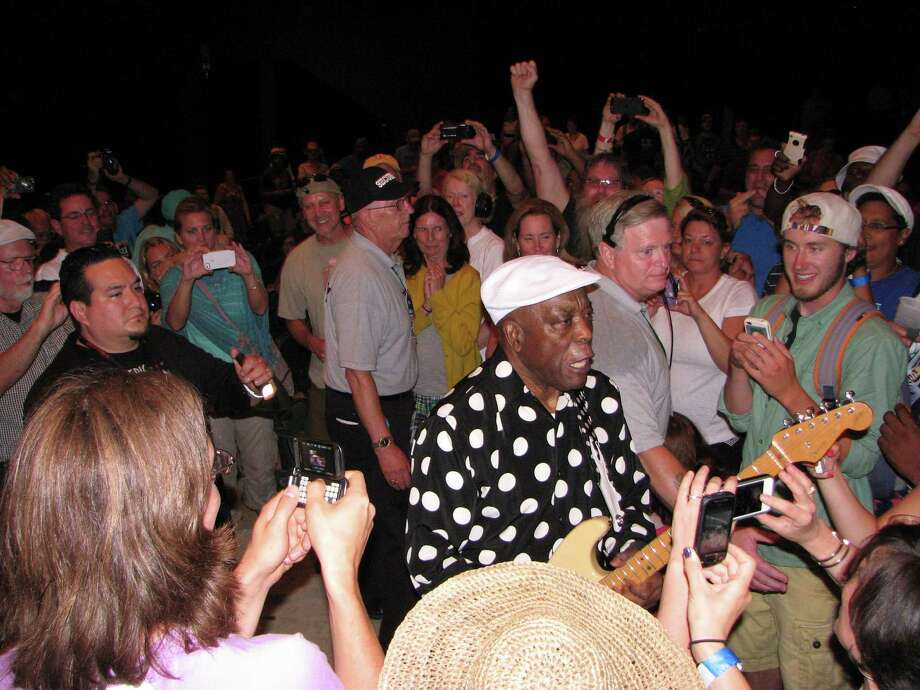 Buddy Guy, 76 years old and still wailing the blues, walks into the crowd during his show-closing set on the final day of the 35th Freihofer's Saratoga Jazz Festival at SPAC on Sunday, June 30, 2013. Photo: Michael Huber