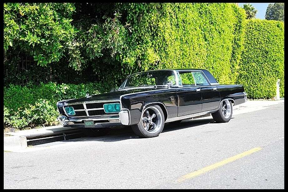 """This four-door 1965 Crown Imperial sedan was usedin the 2011 rendition of """"The Green Hornet."""" Mecum says the car also comes with some custom """"Hornet"""" details."""