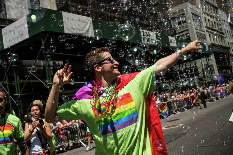 NEW YORK, NY - JUNE 30:  Revelers march in the New York Gay Pride Parade on June 30, 2013 in New York City.  This year's parade was a particularly festive occasion, due to the recent Supreme Court Ruling that it was unconstitutional to ban gay marriage.  (Photo by Andrew Burton/Getty Images) ORG XMIT: 170375947 Photo: Andrew Burton, Getty / 2013 Getty Images
