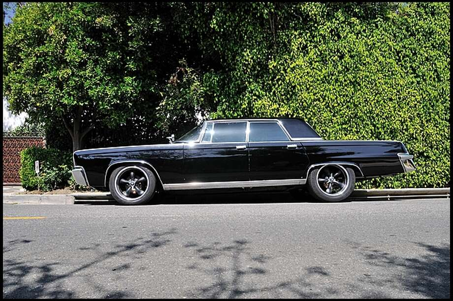 "four-door sedan used in the 2011 version of The Green Hornet will go up for auction in July. Mecum says the car comes with some custom ""hornet"" details."