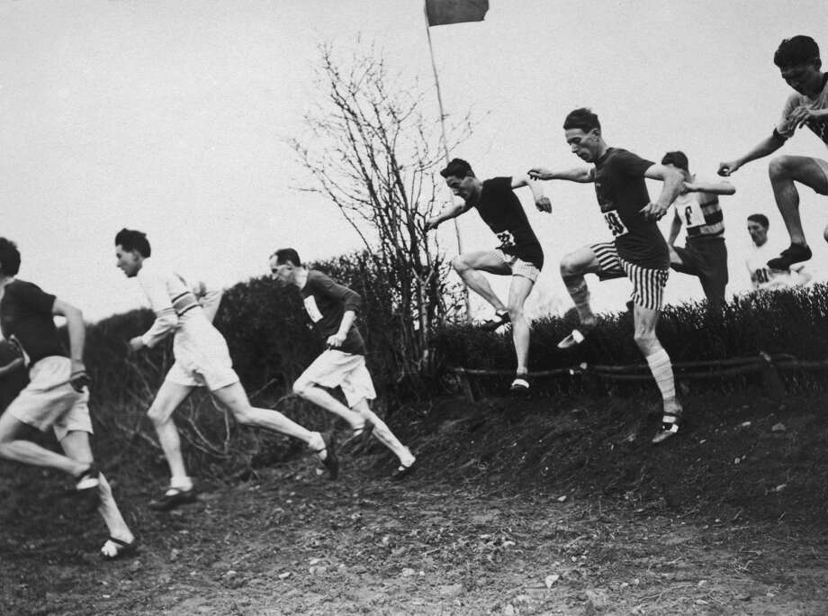 Competitors in the National Cross Country Championships in Hereford, March 1922. (Photo by Topical Press Agency/Hulton Archive/Getty Images)