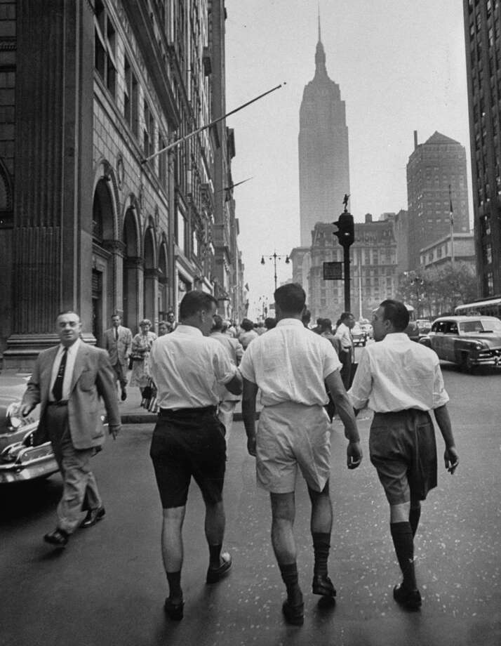Rear view of three young businessmen wearing Bermuda shorts as they walk along Fifth Ave. during lunchtime.  (Photo by Lisa Larsen//Time Life Pictures/Getty Images)