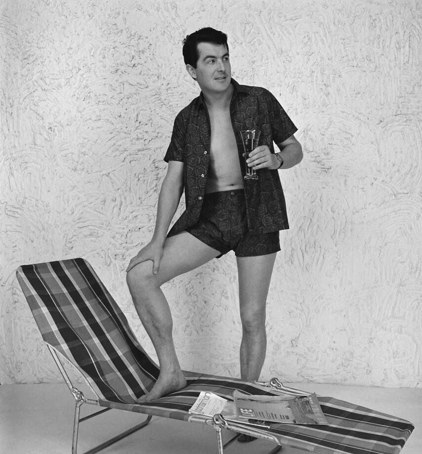 A man wearing an open shirt and matching shorts in a photoshoot for ICI Fibres, 24th August 1965. (Photo by Hulton Archive/Getty Images)
