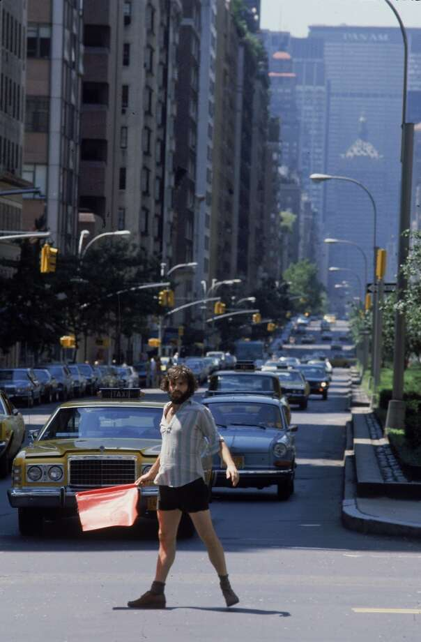 A unidentified man directs traffic on Park Ave. while stoplights were out due to power outage, New York, New York, August 14, 1977. The outage, which occured during a summer heat wave and resulted in widespread looting and property damage, began at 9:34pm the previous evening, lasted approximately 25 hours. The Pam Am building is visible in the distance. (Photo by Dirck Halstead/Time Life Pictures/Getty Images)