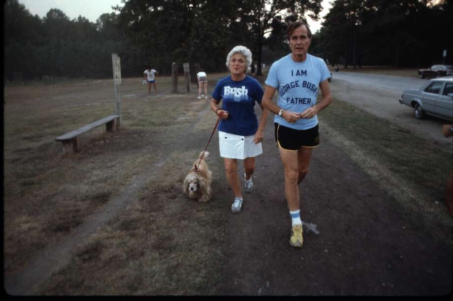 Republican Presidential candidate George Bush wearing a t-shirt referencing his son Geroge W. Bush, walks with his wife Barbara and dog Fred November 1978 in New Hampshire. (Photo by Dirck Halstead/Liaison)