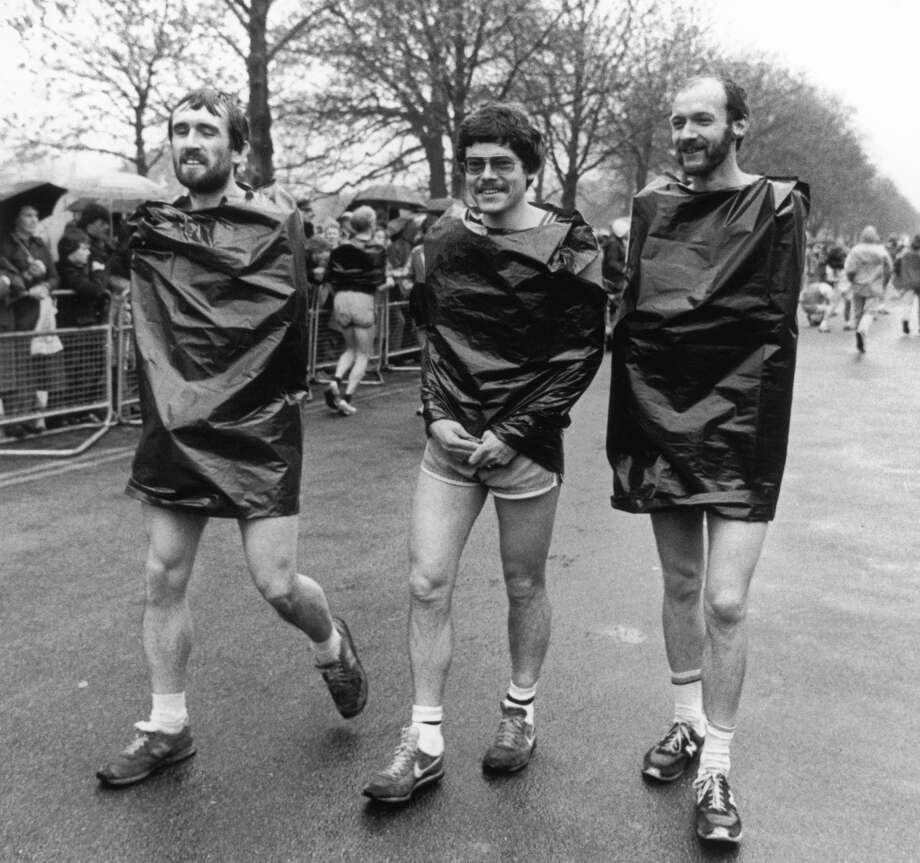 Competitors in the first ever London Marathon wearing bin liners against the rain, 29th March 1981. (Photo by Popperfoto/Getty Images)