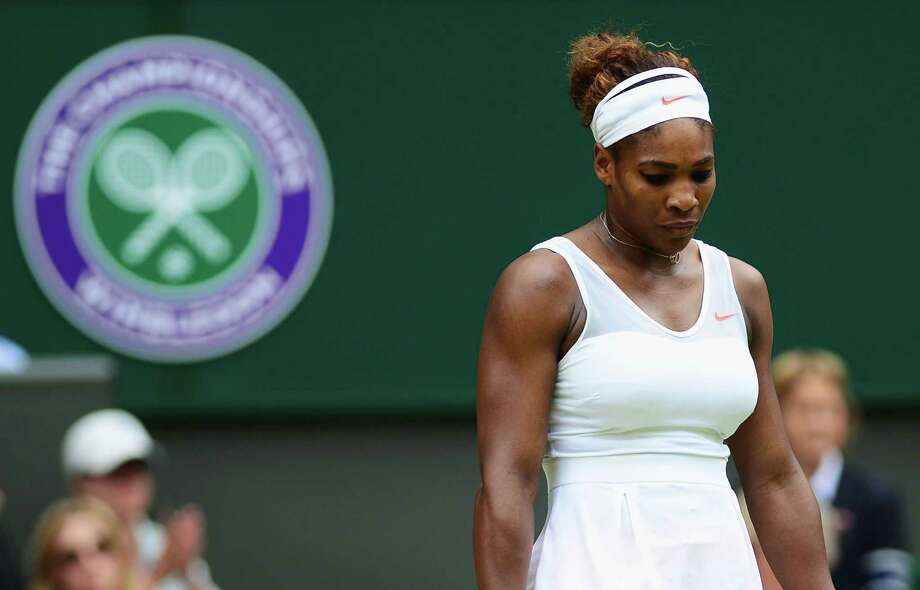 LONDON, ENGLAND - JULY 01:  Serena Williams of United States of America looks dejected during her Ladies' Singles fourth round match against Sabine Lisicki of Germany on day seven of the Wimbledon Lawn Tennis Championships at the All England Lawn Tennis and Croquet Club on July 1, 2013 in London, England. Photo: Mike Hewitt, Getty Images / 2013 Getty Images