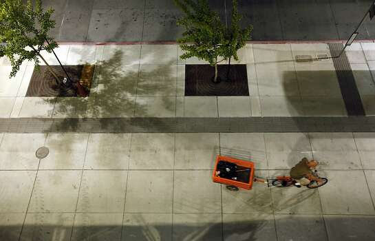A bicyclist rides on empty sidewalks at the Pleasant Hill BART station after the final SFO-bound train departed the station on Monday, July 1, 2013. Negotiations between BART and its unions broke down late Sunday evening, June 30, 2013, in Oakland, Calif., almost assuring a strike by Monday morning. Photo: Carlos Avila Gonzalez, The Chronicle