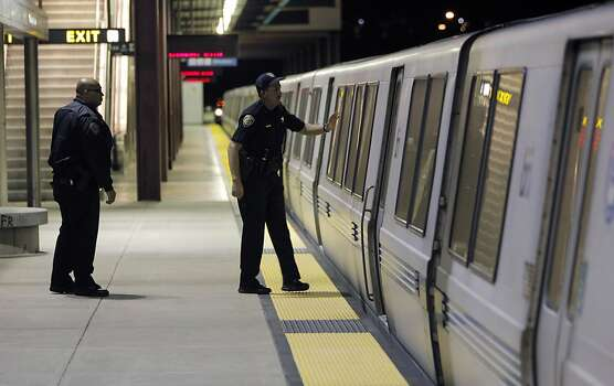 BART police officers check the final train at the Bay Point station for stragglers on Monday, July 1, 2013, as the system shut down for the night. Negotiations between BART and its unions broke down late Sunday evening, June 30, 2013, in Oakland, Calif., almost assuring a strike by Monday morning. Photo: Carlos Avila Gonzalez, The Chronicle