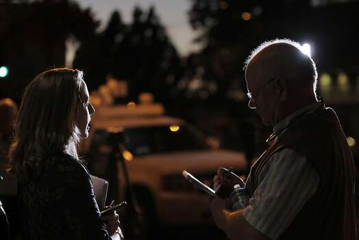 BART spokesperson Alicia Trost speaks to a member of the press after a press conference Sunday. Negotiations between BART and its unions broke down late Sunday evening, June 30, 2013, in Oakland, Calif., almost assuring a strike by Monday morning. Photo: Carlos Avila Gonzalez, The Chronicle