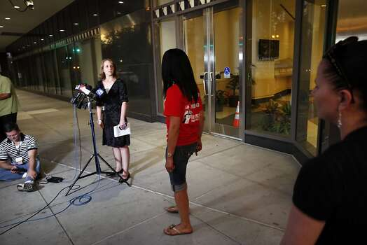BART spokesperson Alicia Trost is interrupted by union members Yuri Holley and Nicole McCamish during a press conference Sunday. Negotiations between BART and its unions broke down late Sunday evening, June 30, 2013, in Oakland, Calif., almost assuring a strike by Monday morning. Photo: Carlos Avila Gonzalez, The Chronicle