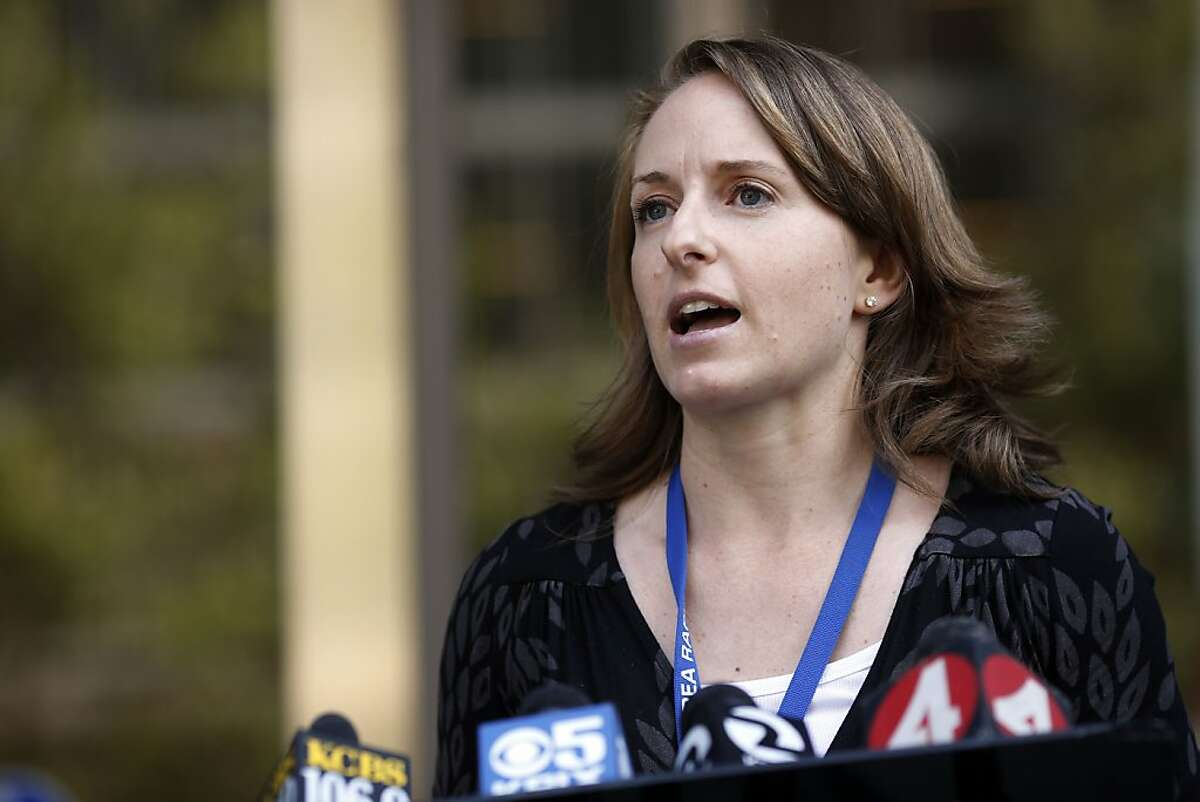 Alicia Trost, a spokesperson for BART, talks with the media outside of the Caltrans building during negotiations between BART officials and union members in Oakland, Calif. on June 30, 2013.