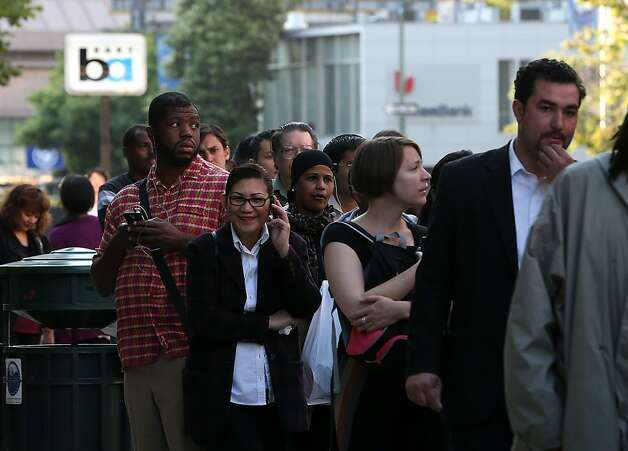 OAKLAND, CA - JULY 01:  Commuters line up as they wait to board an AC Transit bus on July 1, 2013 in Oakland, California. Hundreds of thousands of San Francisco Bay Area commut
