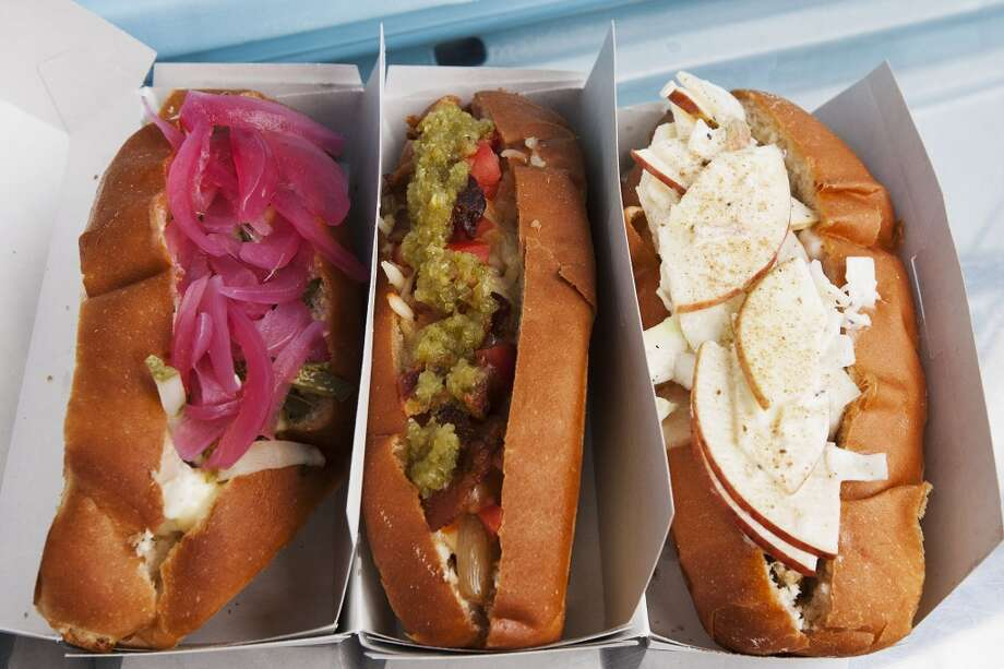 The Sunshine Dog,  Ol' Zapata Dog, and Sloppy Slaw Dog at Good Dog Hot Dogs. Photo: Patrick T Fallon, Houston Chronicle