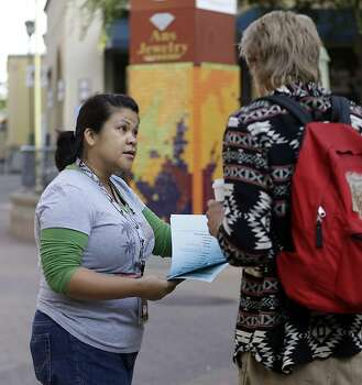 Tina Ebojo, left, an employee of AC Transit, offers alternative travel information to a BART commuter who was unaware of a the strike Monday, July 1, 2013, in Oakland, Calif. Negotiations between the two largest unions representing more than 2,300 Bay Area Rapid Transit workers and BART management broke off late Sunday despite the request of California Gov. Jerry Brown in a last-ditch effort to reach a deal. (AP Photo/Ben Margot) Photo: Ben Margot, Associated Press