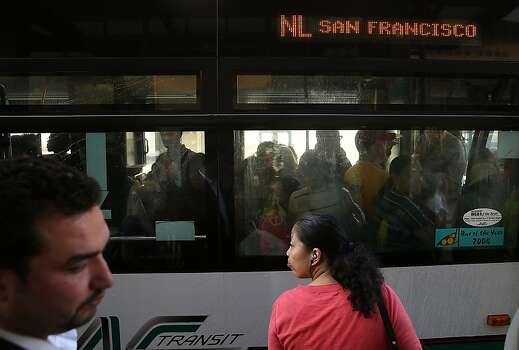 OAKLAND, CA - JULY 01:  Commuters line up as they wait to board an AC Transit bus on July 1, 2013 in Oakland, California. Hundreds of thousands of San Francisco Bay Area commuters are scrambling to find ways to work after the Bay Area Rapid Transit (BART) workers from the Amalgamated Transit Union Local 1555 went on strike at midnight after contract negotiations with management fell apart on Sunday. Train operators, mechanics, station agents and maintenance workers are seeking a five percent wage increase and are fighting management who want to have workers to begin contributing to their pensions, pay more for health insurance and reduce overtime expenses.  (Photo by Justin Sullivan/Getty Images) Photo: Justin Sullivan, Getty Images