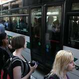 OAKLAND, CA - JULY 01:  Commuters line up as they wait to board an AC Transit bus on July 1, 2013 in Oakland, California. Hundreds of thousands of San Francisco Bay Area commuters are scrambling to find ways to work after the Bay Area Rapid Transit (BART) workers from the Amalgamated Transit Union Local 1555 went on strike at midnight after contract negotiations with management fell apart on Sunday. Train operators, mechanics, station agents and maintenance workers are seeking a five percent wage increase and are fighting management who want to have workers to begin contributing to their pensions, pay more for health insurance and reduce overtime expenses.  (Photo by Justin Sullivan/Getty Images)