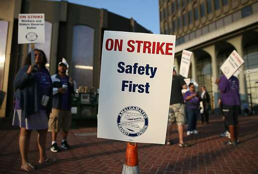 BERKELEY, CA - JULY 01:  Amalgamated Transit Union workers hold signs as they strike outside of a Bay Area Rapid Transit (BART) station on July 1, 2013 in Berkeley, California. Hundreds of thousands of San Francisco Bay Area commuters are scrambling to find ways to work after the Bay Area Rapid Transit (BART) workers from the Amalgamated Transit Union Local 1555 went on strike at midnight after contract negotiations with management fell apart on Sunday. Train operators, mechanics, station agents and maintenance workers are seeking a five percent wage increase and are fighting management who want to have workers to begin contributing to their pensions, pay more for health insurance and reduce overtime expenses.  (Photo by Justin Sullivan/Getty Images) Photo: Justin Sullivan, Getty Images