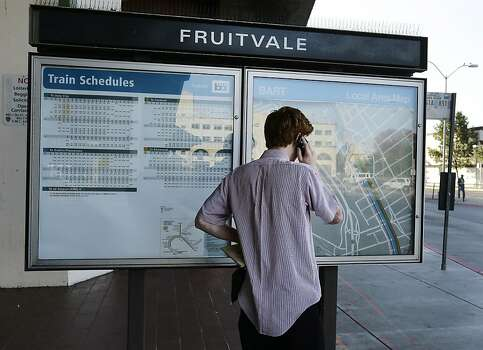 A man makes a phone call upon learning that the Fruitvale BART station is closed due to a strike Monday, July 1, 2013, in Oakland, Calif. Negotiations between the two largest unions representing more than 2,300 Bay Area Rapid Transit workers and BART management broke off late Sunday despite the request of California Gov. Jerry Brown in a last-ditch effort to reach a deal. (AP Photo/Ben Margot) Photo: Ben Margot, Associated Press