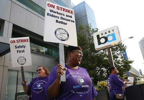 OAKLAND, CA - JULY 01:  Amalgamated Transit Union workers hold signs as they strike outside of a Bay Area Rapid Transit (BART) station on July 1, 2013 in Oakland, California. Hundreds of thousands of San Francisco Bay Area commuters are scrambling to find ways to work after the Bay Area Rapid Transit (BART) workers from the Amalgamated Transit Union Local 1555 went on strike at midnight after contract negotiations with management fell apart on Sunday. Train operators, mechanics, station agents and maintenance workers are seeking a five percent wage increase and are fighting management who want to have workers to begin contributing to their pensions, pay more for health insurance and reduce overtime expenses.  (Photo by Justin Sullivan/Getty Images) Photo: Justin Sullivan, Getty Images