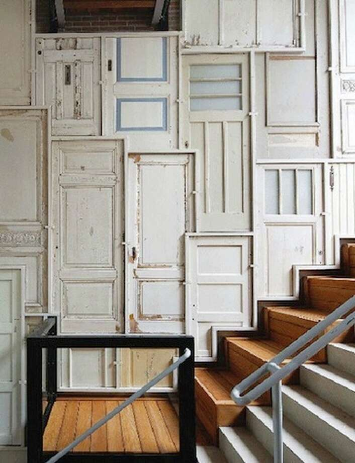 Wall texture via old doors. Photo source: tendir.com via Zillow.