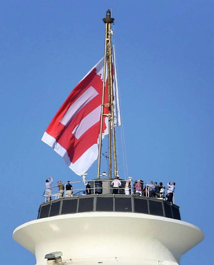 A marriage equality flag is hoisted on the roof of the Space Needle. You can read more about the flag on the Space Needle here. Photo: JOSHUA TRUJILLO, SEATTLEPI.COM