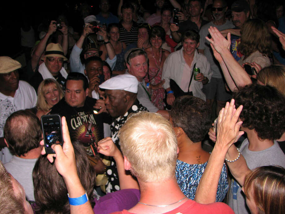 Buddy Guy, 76 years old and still wailing the blues, walks into the crowd during his show-closing set on the final day of the 35th Freihofer's Saratoga Jazz Festival at SPAC on Sunday, June 30, 2013.