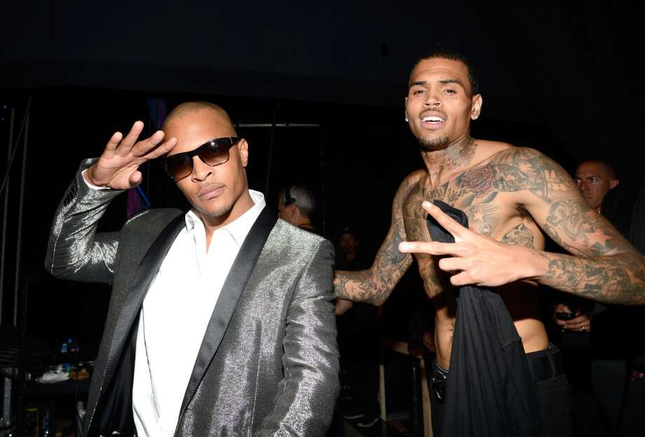 LOS ANGELES, CA - JUNE 30:  Recording artists T. I. (L) and Chris Brown pose backstage during the 2013 BET Awards at Nokia Theatre L.A. Live on June 30, 2013 in Los Angeles, California.  (Photo by Kevin Mazur/BET/Getty Images for BET)