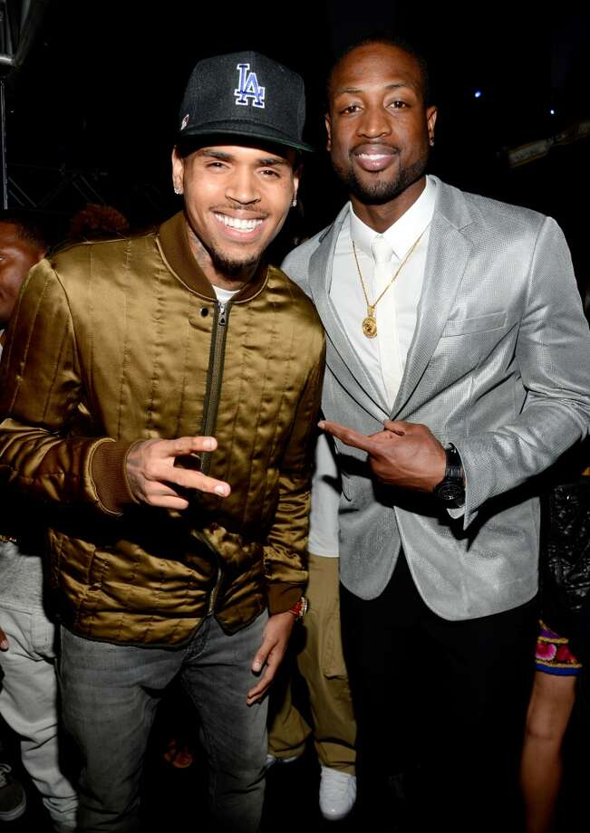 LOS ANGELES, CA - JUNE 30: Recording artist Chris Brown (L) and NBA player Dwayne Wade pose backstage during the 2013 BET Awards at Nokia Theatre L.A. Live on June 30, 2013 in Los Angeles, California.  (Photo by Kevin Mazur/BET/Getty Images for BET)