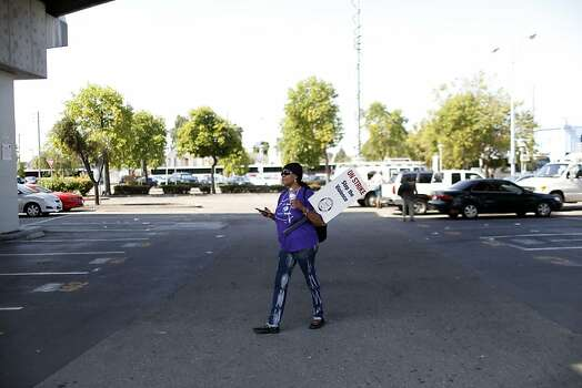 Mimi Powe walks through the West Oakland BART station during strikes against BART in Oakland, Calif. on July 1, 2013. Photo: Ian C. Bates, The Chronicle